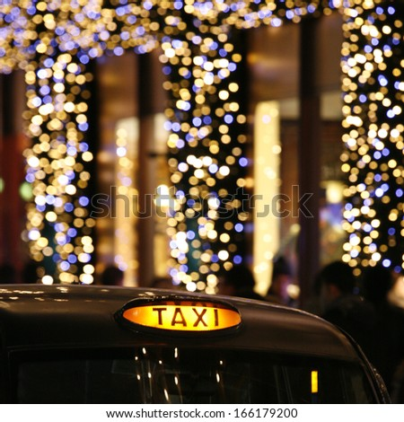 London Taxi with illuminated Christmas Decoration, urban night view.   - stock photo
