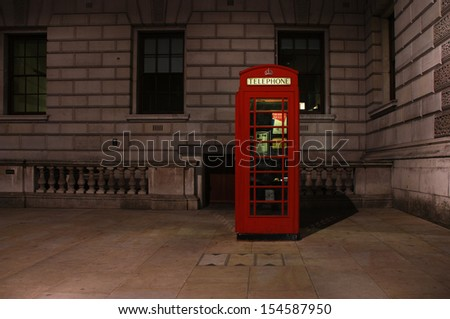 London telephone booth at night - stock photo