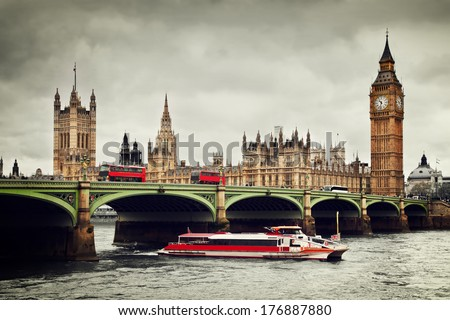 London, the UK. Big Ben, the Palace of Westminster and the River Thames. Red buses, red boat, the icons of England in vintage, retro style - stock photo