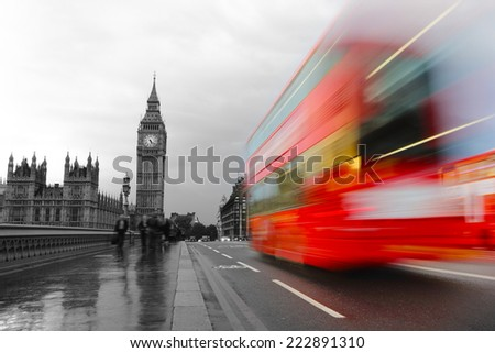 London, the UK. Red bus in motion and Big Ben, the Palace of Westminster. in retro monochrome style - stock photo