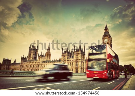 London, the UK. Red bus, taxi cab in motion and Big Ben, the Palace of Westminster. The icons of England in vintage, retro style - stock photo