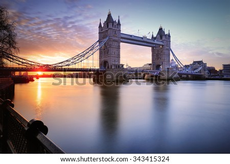 London Tower Bridge and Thames river viewed at sunrise in London, England.