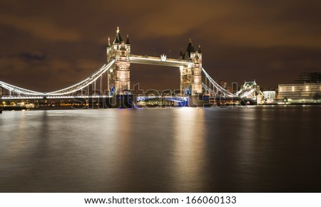 London Tower bridge on sunset illuminated with different colors