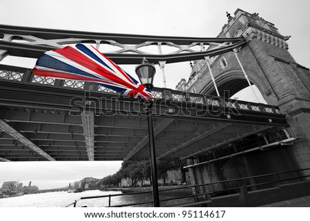 London Tower Bridge with colorful flag of England
