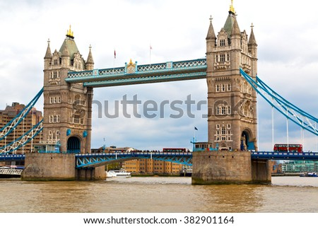 london tower in england old bridge and the cloudy sky - stock photo