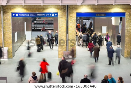London Train Tube station Blur people movement in rush hour at King's Cross station, England, UK  - stock photo