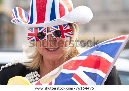LONDON, UK - APRIL 28: A day before William and Kate's wedding, the excitement soars up at the Buckingham Palace and on the Mall, April 28, 2011 in London, United Kingdom - stock photo