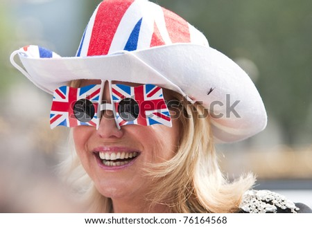 LONDON, UK - APRIL 28: A day before William and Kate's wedding, the excitement soars up at the Buckingham Palace and on the Mall, April 28, 2011 in London, United Kingdom