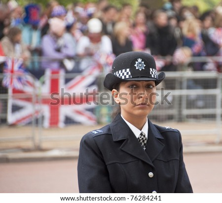 LONDON, UK - APRIL 29: A police woman at Prince William and Kate Middleton wedding, April 29, 2011 in London, United Kingdom - stock photo