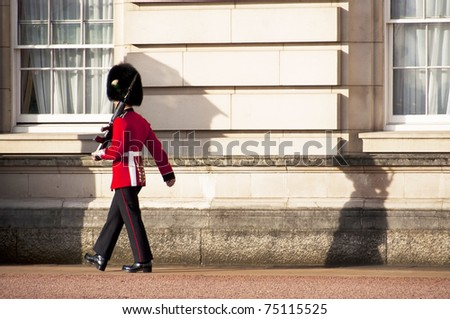 LONDON, UK - APRIL 7: A royal guard at Buckingham Palace which will be the starting point of the royal wedding procession to be held on Friday 29th April, April 7, 2011 in London, United Kingdom - stock photo