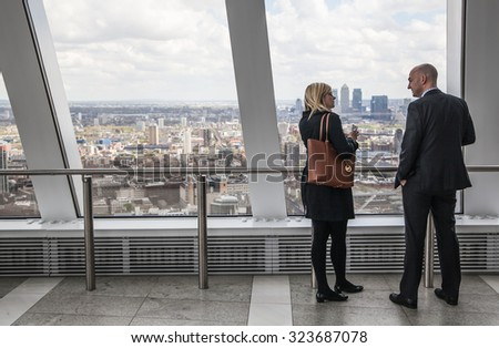 LONDON, UK - APRIL 22, 2015: Business people watching London skyline from the 32 floor of viewing hall
