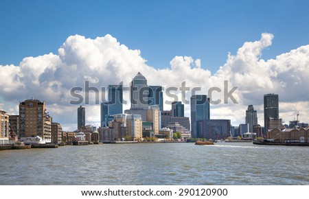 LONDON, UK - APRIL 30, 2015:  Canary Wharf business aria view from the River Thames - stock photo