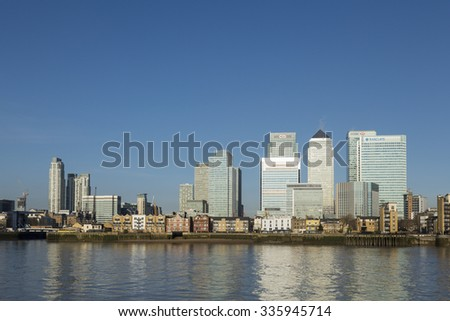 LONDON, UK - APRIL 07, 2015: Canary Wharf skyline shows business district banks. Canary Wharf is a major business district located in Tower Hamlets.