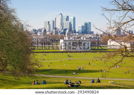 LONDON, UK - APRIL 14, 2015: Canary Wharf view from the Greenwich hill. Modern skyscrapers of banking aria - stock photo