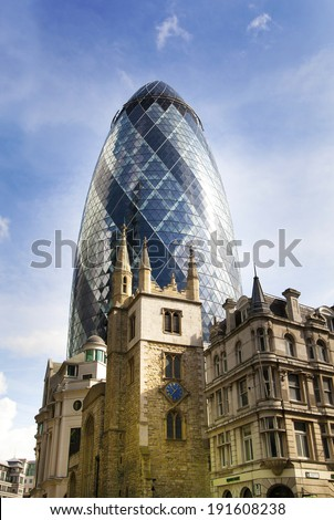LONDON, UK - APRIL 24, 2014: City of London one of the leading centres of global finance, headquarters for leading banks, insurance, stock exchange, media, law and other businesses. Gherkin building  - stock photo