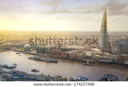 LONDON, UK - APRIL 22, 2015: City of London panorama in sunset. Shard of glass and river Thames - stock photo