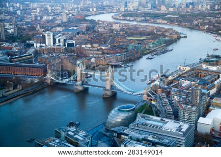 LONDON, UK - APRIL 15, 2015: City of London panorama in sunset. Tower bridge and River Thames  - stock photo