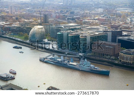 LONDON, UK - APRIL 22, 2015: City of London panorama. London hall and old battle ship - stock photo