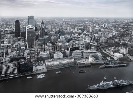 LONDON, UK - APRIL 15, 2015: City of London panorama, office and banking district arial view - stock photo