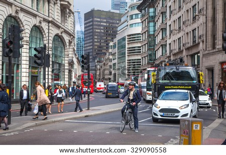 LONDON, UK - APRIL 22, 2015: City of London street view with buses and cars
