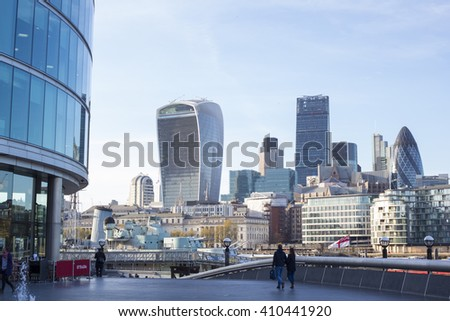 LONDON, UK  - APRIL 19, 2016: City of London, the financial district of London, at sunset. View includes Tower 42 Gherkin,Willis Building, Stock Exchange Tower Lloyd`s of London and Walkie Talkie. - stock photo