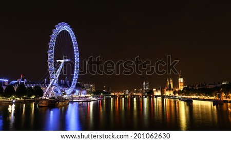 LONDON, UK - APRIL 23, 2014: Cityscape of London at night with the London Eye, Houses of Parliament, Big Ben and Thames - stock photo