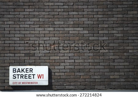 LONDON, UK - APRIL 22: Dark brick wall with Baker Street sign at the bottom corner. April 22, 2015 in London.  The street was brought to fame by Sherlock Holmes's adventures. - stock photo