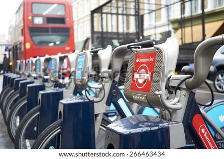 LONDON, UK - APRIL 02: Detail of Boris bikes in line. April 02, 2015 in London. On 27 February 2015. Mayor Boris Johnson secured Santander's sponsorship on the bike's scheme to replace Barclays bank. - stock photo