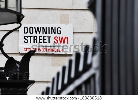 LONDON, UK - APRIL 10, 2009: Downing Street's sign in Westminster. Downing St. has housed government leaders for over three hundred years. - stock photo