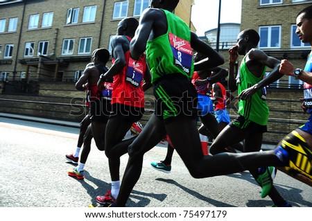 LONDON, UK - APRIL 17, 2011 - Emmanuel Mutai (#8) runs with the main group of marathones in the Virgin Maraton April 17 in London - stock photo