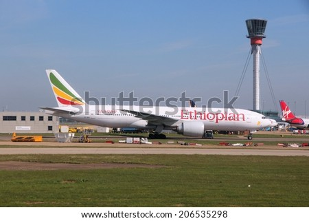 LONDON, UK - APRIL 16, 2014: Ethiopian Airlines Boeing 777 at London Heathrow airport. Ethiopian carried 6 million passengers in 2013. - stock photo