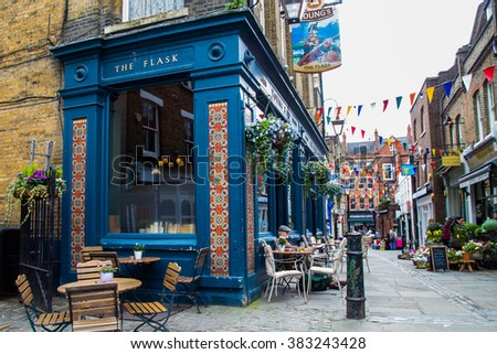 LONDON, UK -  April, 13:  Exterior of pub, for drinking and socializing  with oriental ornaments. Typical London street - stock photo