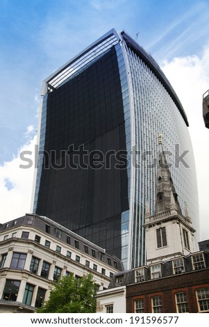 LONDON, UK - APRIL 24, 2014: Famous Walkie Talkie building still keeps iconic glass  wall cowered. Wall was covered after it had started reflect very strong sun hit down on properties, roads and cars
