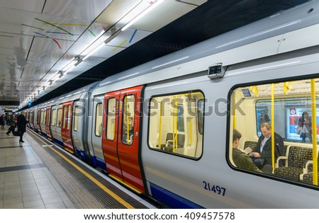 London, UK - April 7, 2016: Inside view of London Underground Tube Station with Moving train, motion blurred. - stock photo