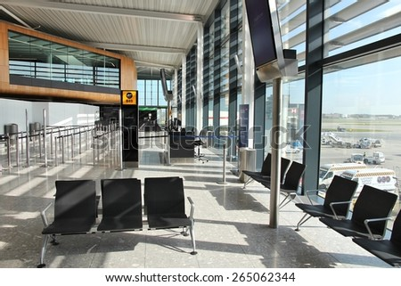 LONDON, UK - APRIL 16, 2014: Interior view of London Heathrow Airport in UK. Heathrow is the 3rd busiest airport in the world with 73.4 million passengers handled in 2014. - stock photo