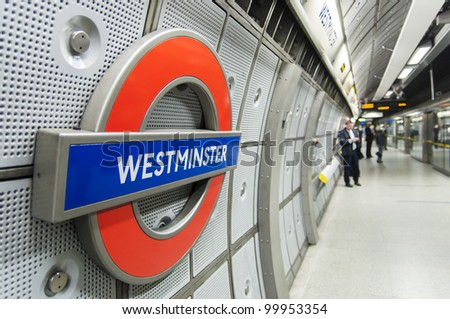 LONDON, UK - APRIL 02: London Westminster underground station. April 02, 2012 in London. The station is the main access to the Houses of Parliament, home to the British government. - stock photo