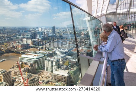 LONDON, UK - APRIL 22, 2015: People in Sky Garden Walkie-Talkie building. Viewing platform is highest UK garden, locates at the 32 floor and offers amazing skyline of London city. - stock photo