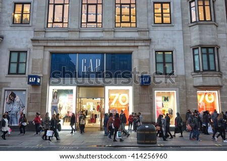 LONDON, UK - APRIL 23, 2016: People shop at The Gap, Oxford Street in London. Oxford Street has approximately half a million daily visitors and 320 stores. - stock photo