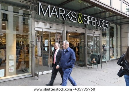 LONDON, UK - APRIL 22, 2016: People shop in Marks and Spencer in London, UK. M&S is a major retailer with 1,010 stores in 41 countries. It specializes in fashion and luxury goods. - stock photo