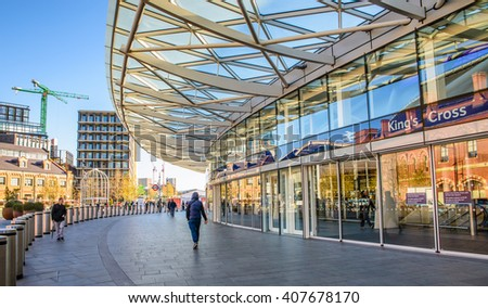 LONDON, UK - APRIL 18, 2016: People wait outside the departures concourse at King's Cross Station in London. - stock photo