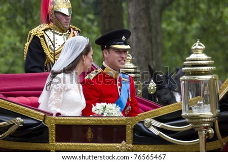 LONDON, UK - APRIL 29: Prince William and Kate Middleton ride in a carriage on there way to Buckingham Palace after their wedding on the April 29, 2011 in London, UK - stock photo