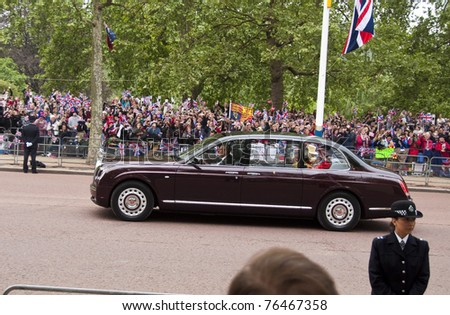 LONDON, UK - APRIL 29: Queen Elizabeth and the Duke of Edinburgh in their Rolls-Royce at Prince William and Kate Middleton wedding, April 29, 2011 in London, United Kingdom - stock photo
