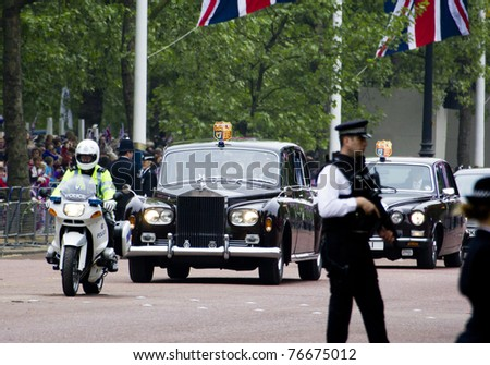 LONDON, UK - APRIL 29: Queen Elizabeth and the Duke of Edinburgh in their Rolls-Royce on April 29, 2011 in London, United Kingdom - stock photo