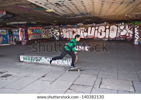 LONDON, UK- APRIL 15: Skateboarders and BMX bikers use the undercroft at the Southbank. Hailed as the birthplace of British skateboarding it is now under threat of closure  April 15, 2013 London UK - stock photo
