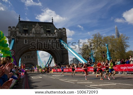LONDON, UK - APRIL 22: Tens of thousands of runners pass tower bridge during the london 2012 marathon on the April 22 in London, UK
