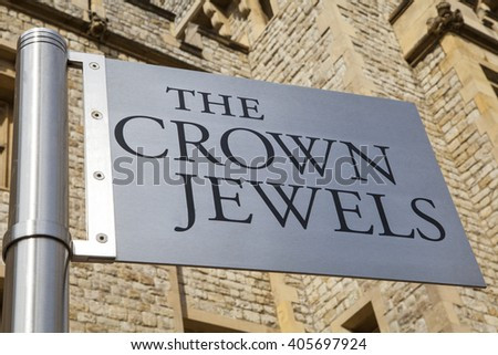 LONDON, UK - APRIL 10TH 2016: A sign pointing towards the location of the Royal Crown Jewels at the Tower of London, on 10th April 2016.