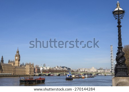 LONDON, UK - APRIL 14TH 2015: A view taking in the sights of the Houses of Parliament, Big Ben, Westminster Bridge, Charing Cross Station, London Eye and the River Thames in London on 14th April 2015. - stock photo