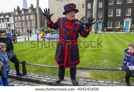 LONDON, UK - APRIL 10TH 2016: A Yeomen Warder talking to visitors during a tour of the historic Tower of London, on 10th April 2016. - stock photo