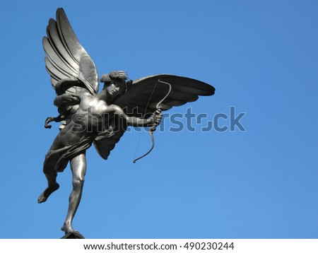 London, UK, April 18, 2009 : The aluminium statue of Eros stands at the top of The Shaftesbury Memorial Fountain in Piccadilly Circus