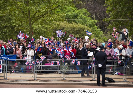LONDON, UK - APRIL 29: The crowd of spectators on the Mall at Prince William and Kate Middleton wedding, April 29, 2011 in London, United Kingdom - stock photo